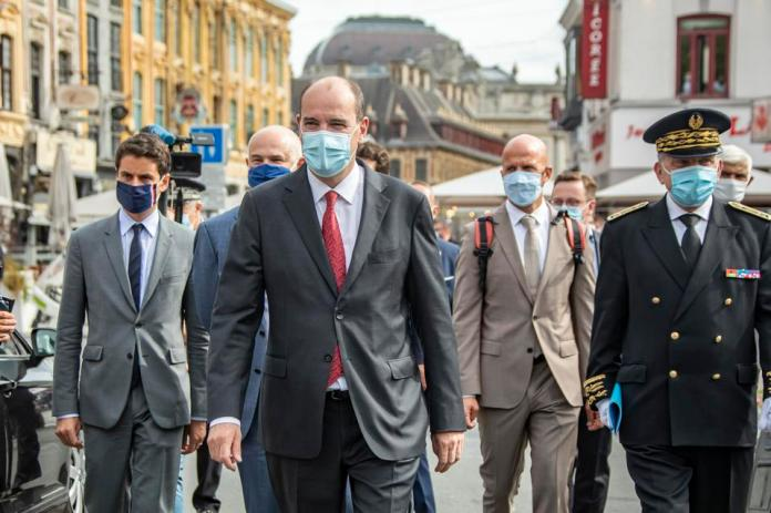 French Prime Minister Jean Castex wears Covid protective mask during visit to Lille France