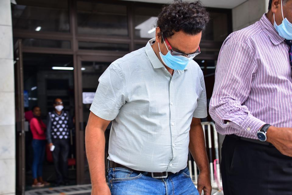 Sunil Kumar Nandeshwar (L), the captain of the Wakashio and his deputy were in court on Tuesday 22 December