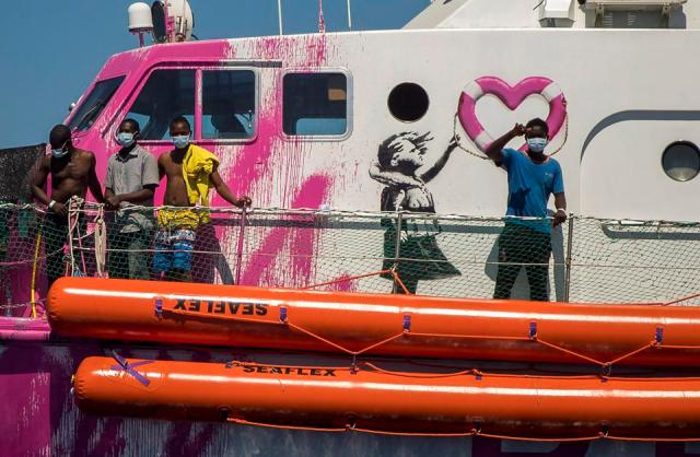 A Banksy-Funded Humanitarian Ship Saves 130 Migrants—But Now Sits Stranded  In The Mediterranean Sea