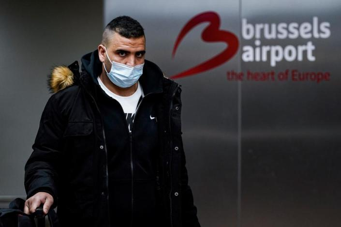 Man at Brussels airport in Belgium with mask as Covid Travel Bans return to Europe