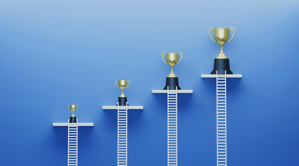white ladders and trophies show rewarded advertising concept