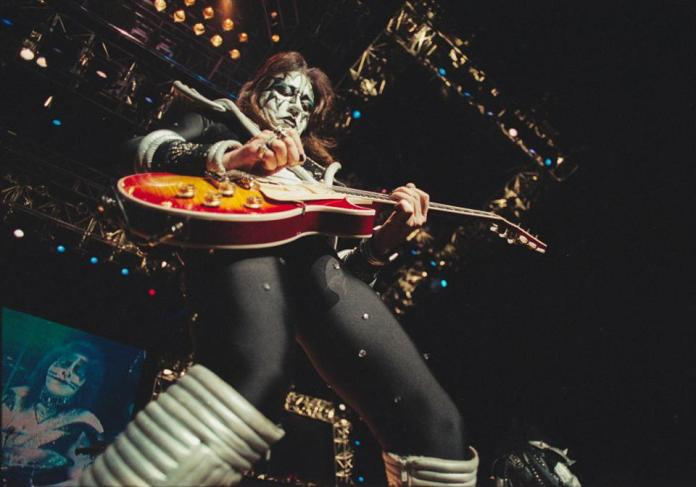Guitarist Ace Frehley performs with rock group KISS on stage at the New World Music Theatre during the ″KISS Farewell Tour.″ September 30, 2000 in Tinley Park, IL (Photo by Barry Brecheisen)