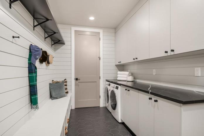 Flex room serves as entry storage and laundry area.