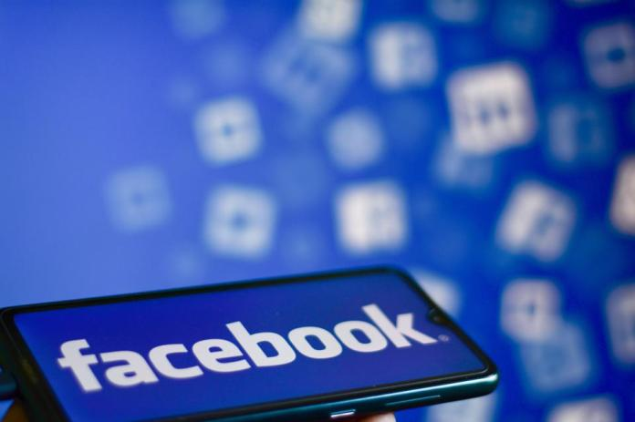 Facebook logo displayed on a smartphone
