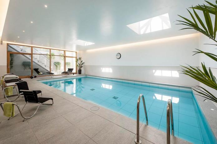 The pool is lit by skylights