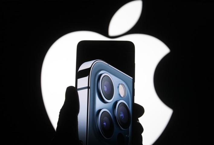 In this photo illustration a screenshot from Apple's launch...