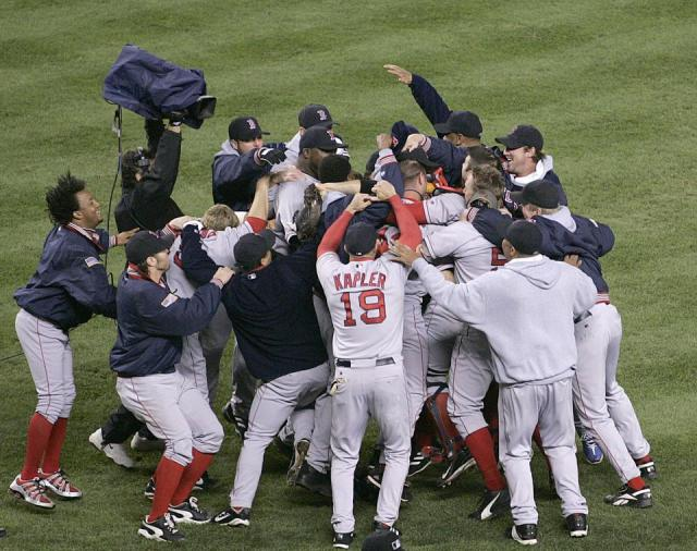 The 2004 Boston Red Sox advance to the World Series after defeating the New York Yankees.