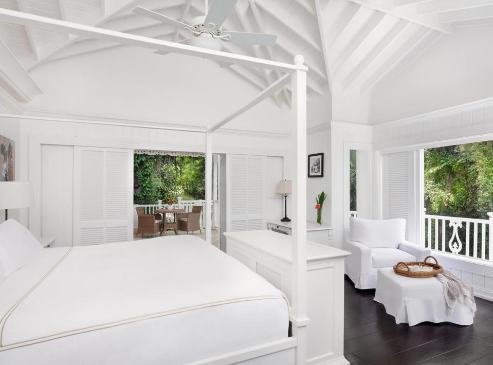 Una villa privada y una cama en Sugar Beach.