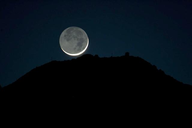 The crescent moon seen from Mill Valley set behind Mount Tamalpais