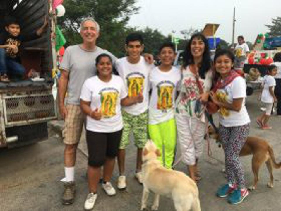 Jet Metier and Chuck Bolotin with Mexican children at Festival of the Virgin of Guadalupe