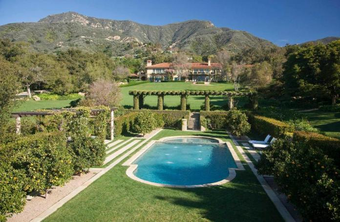 A grand estate with an expansive lawn and swimming pool in Montecito.