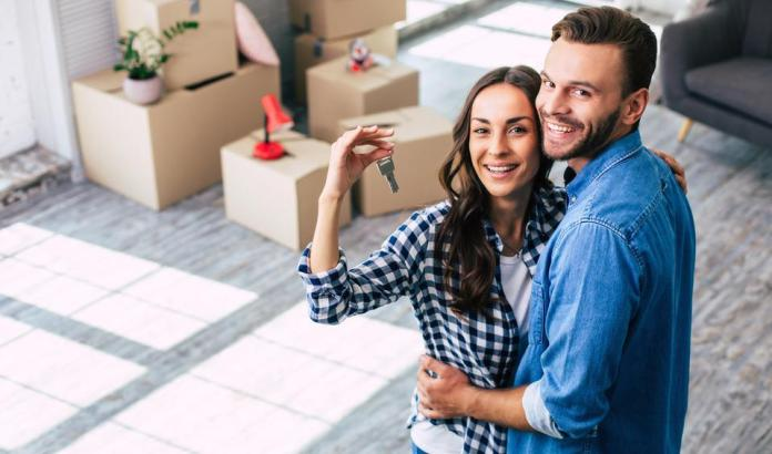 A young couple purchases new home.