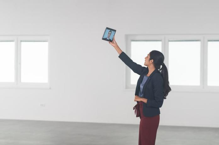 Estate Agent Checking Details For Empty Office
