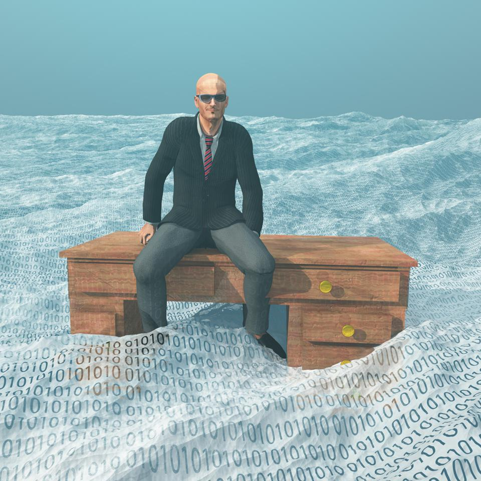 Businessman atop desk afloat on binary ocean