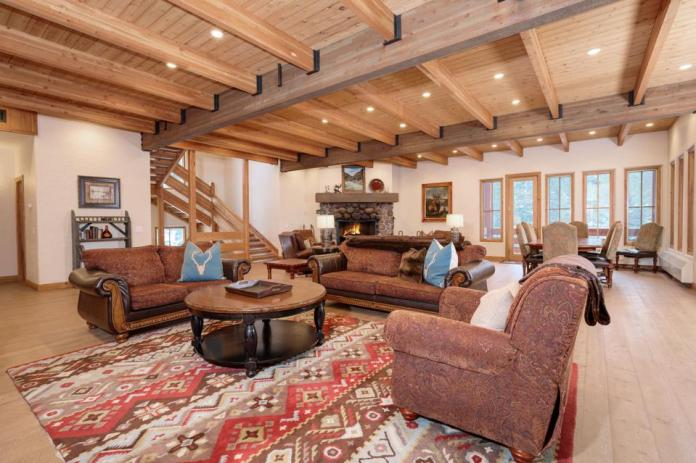 A rustic-style living room inside 47 Saddle Horn.