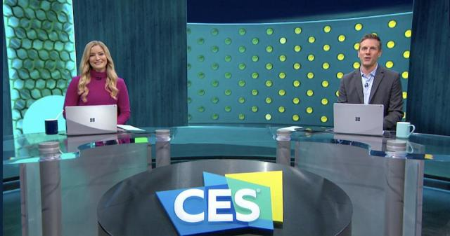 CES 2021 Anchor Desk hosts YouTuber Justine Ezarik (seated in a purple sweater) and KTLA's Rich DeMuro (seated in a grey jacket blue shirt).