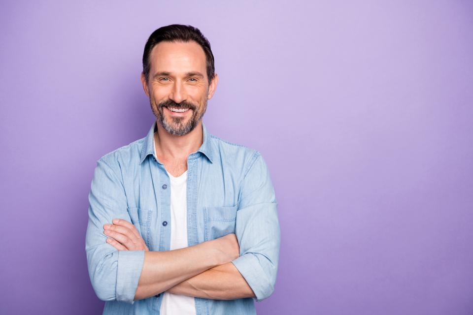 Portrait of charming man cross hands look good like real start-up expert wear stylish clothing isolated over violet color background