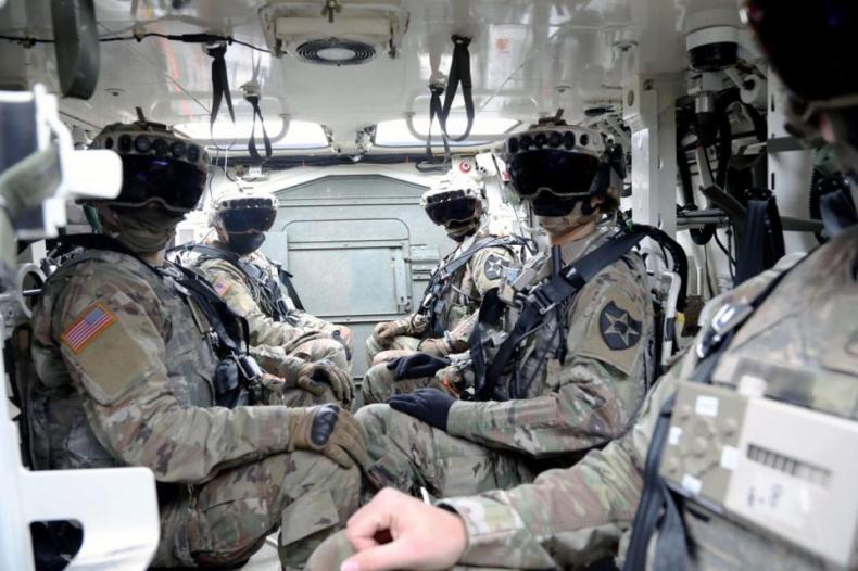 Members of the U.S. Army sporting Microsoft Hololens headsets.