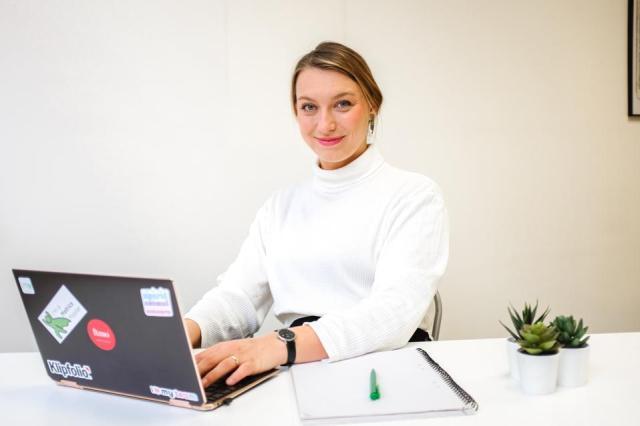 Startup fundraising expert, Melinda Elmborg, seen writing on a laptop.