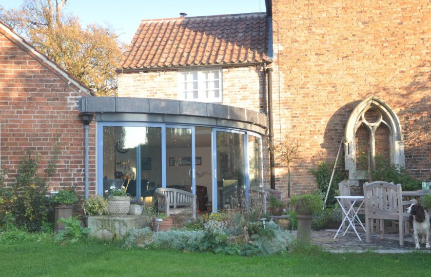 Balcony System's curved patio door complements listed building