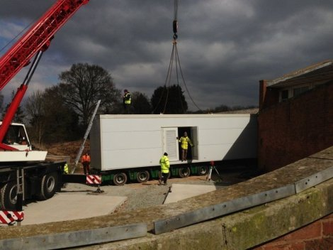 The Energy Cabin being lowered into position at Coddington Court