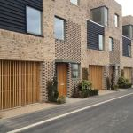 Ventilated garage door systems for new housing project in Cambridge