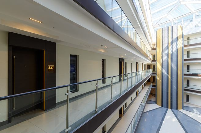 Atrium showing Vicaima Dekordor 3D entrance doors on every floor