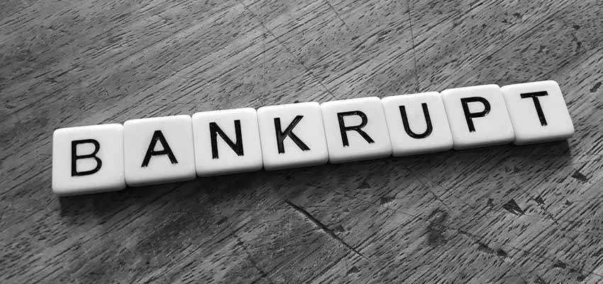 """Letter tiles that spell """"BANKRUPT""""."""