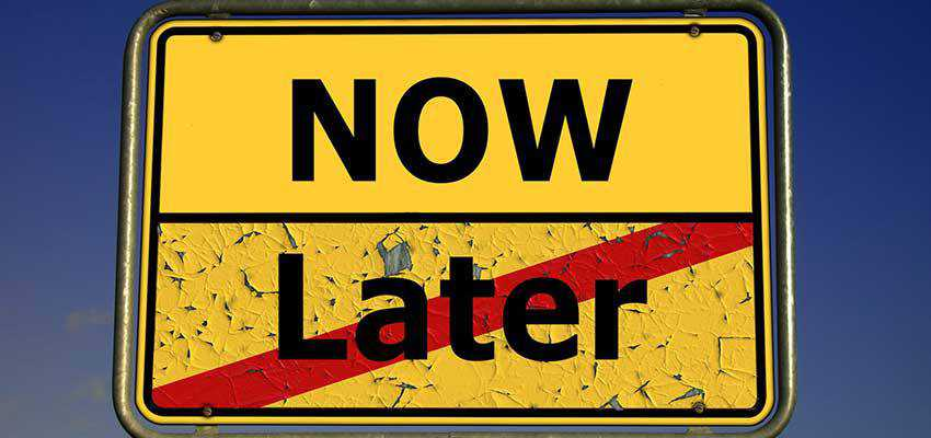 "A road sign with sections that say ""NOW"" and ""Later""."