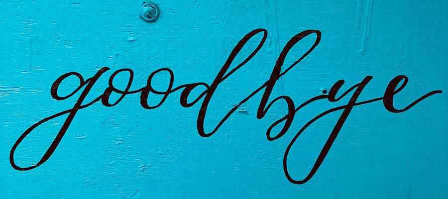 """A wall with the word """"goodbye"""" painted on it."""