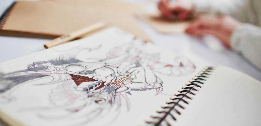 designer sketching notebook