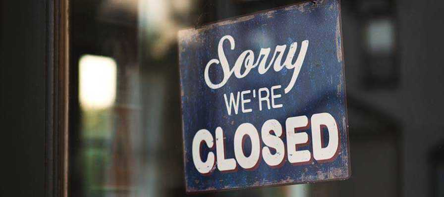 """A sign that reads """"Sorry We're Closed""""."""