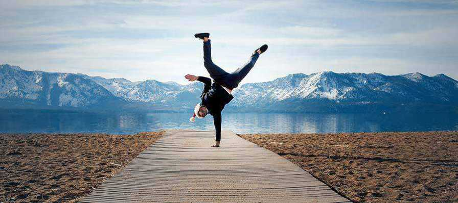 A person doing a hand stand.