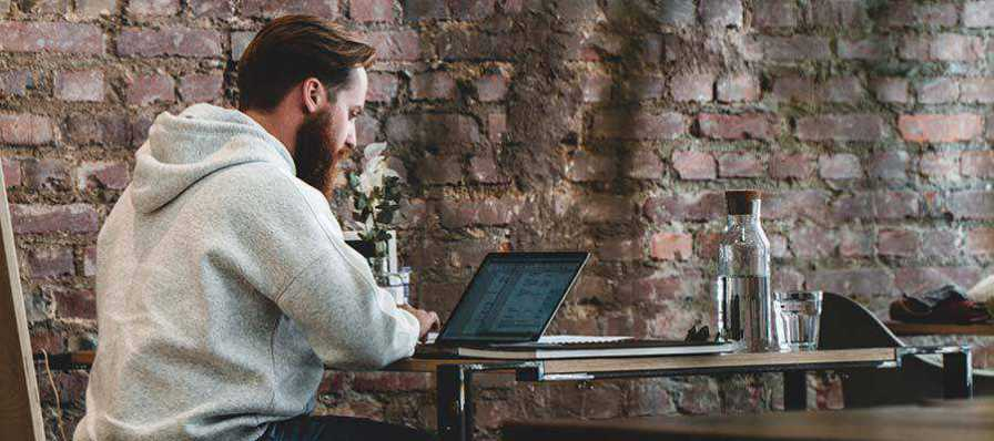 A man using a laptop computer.