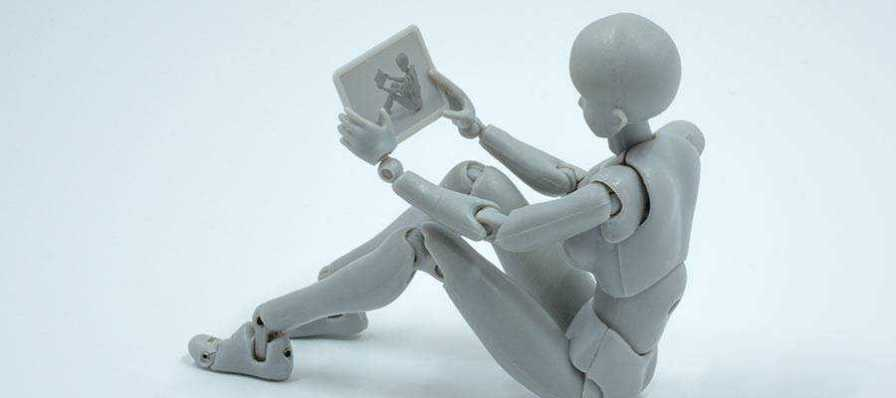A robot holding a tablet computer.