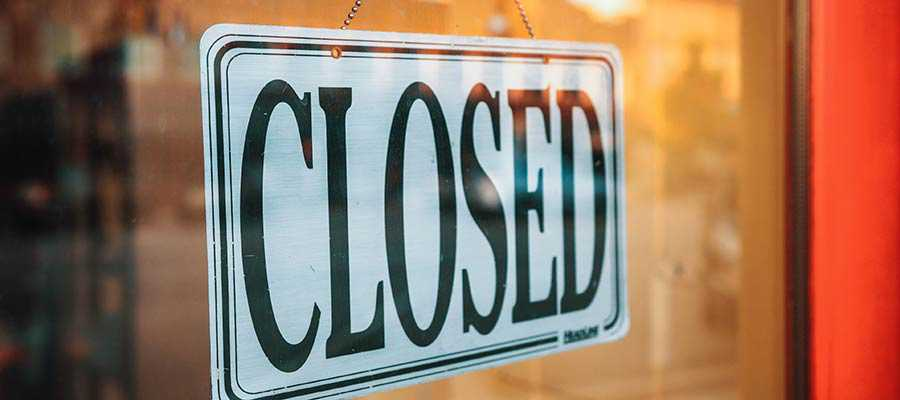 """A sign that reads: """"Closed""""."""
