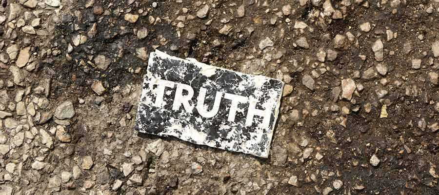 """A sign that reads """"TRUTH""""."""
