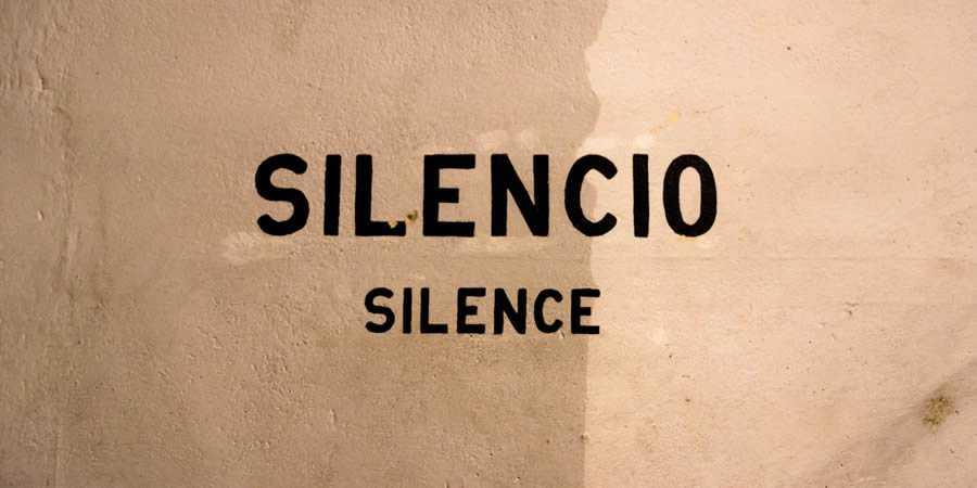 silence silencio painted wall sign