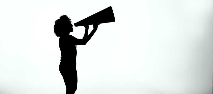 A person speaks into a megaphone.