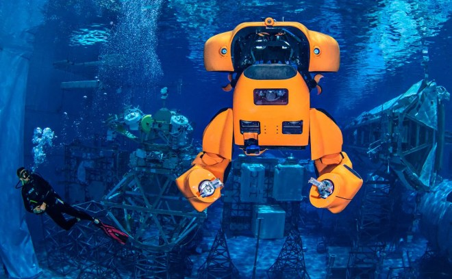 Photo of the robot Aquanaut floats underwater during a test at NASA's Neutral Buoyancy Laboratory.
