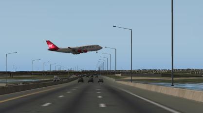 The VS 747 flying over I-295 en route to landing Runway 29.
