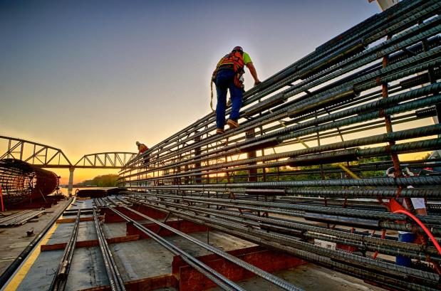 Ironworker's building a caisson at sunrise