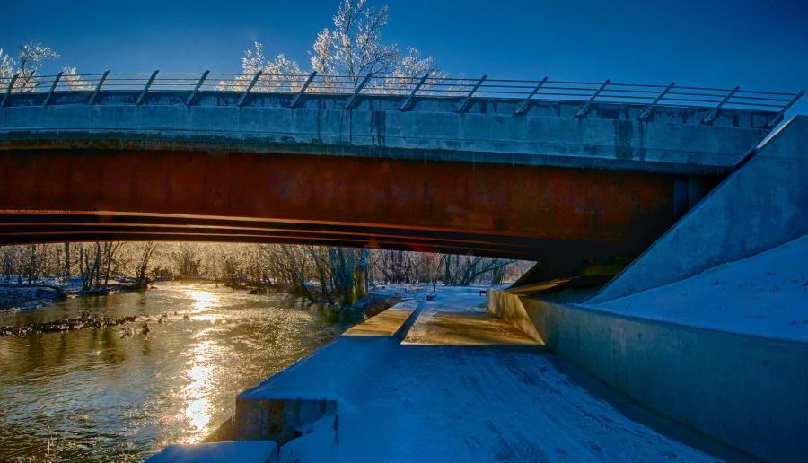 Winter scene of ice and bridge