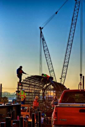 Ironworker's building a caisson at sunrise #2