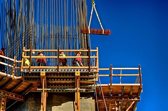 HDR photo of Four Ironworkers on North Tower landing supplies