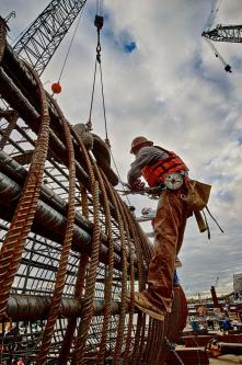 Ironworker Local 70 member Travis tying rebar on a caisson.