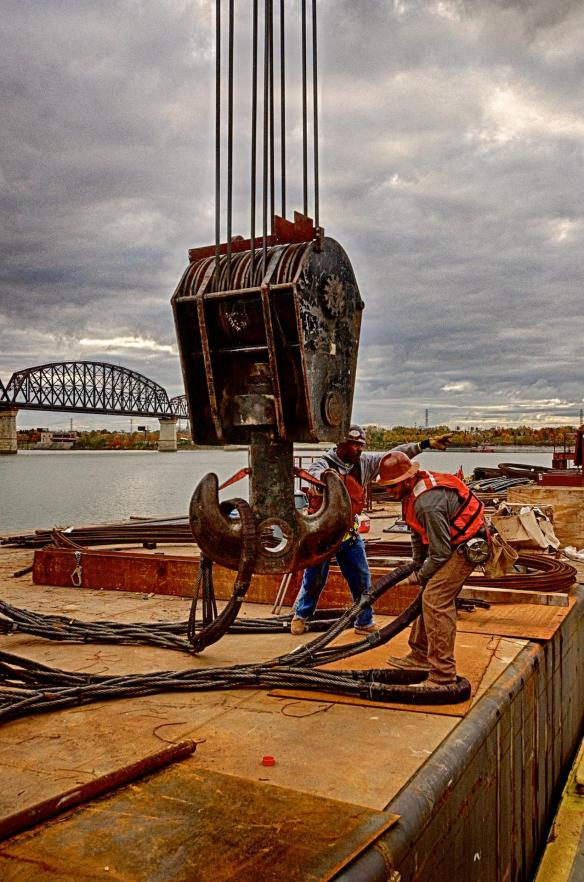 Ironworkers Sean and Travis rigging the caisson for the pick and placement in the pier casing.