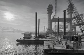 A foggy start to the day as morning fog moves down river toward Tower Five and the structural steel that will carry the new Downtown Span bridge deck. (B&W Version)