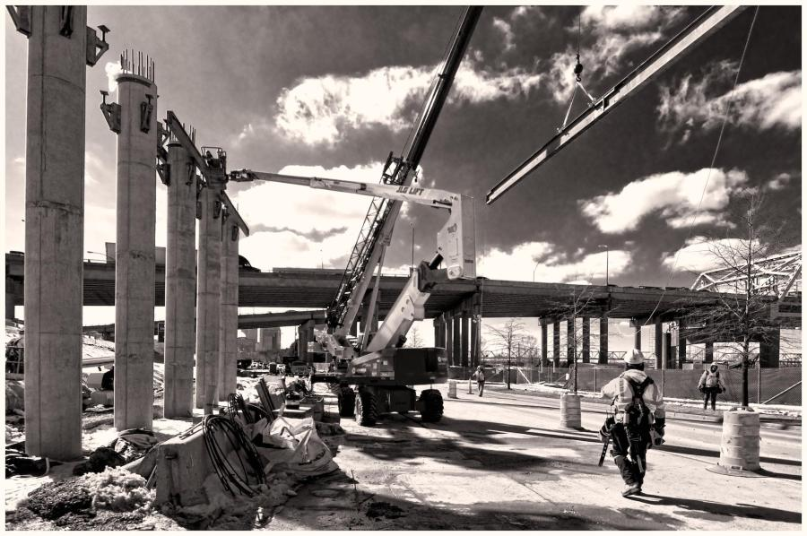 "Carpenters placing a support beam for the ""dance floor"" which will support the concrete forms for another bridge support beam.#2 - Topaz B&W Version"