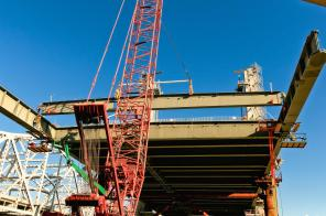 Ironworkers setting a floor beam for the downtown span